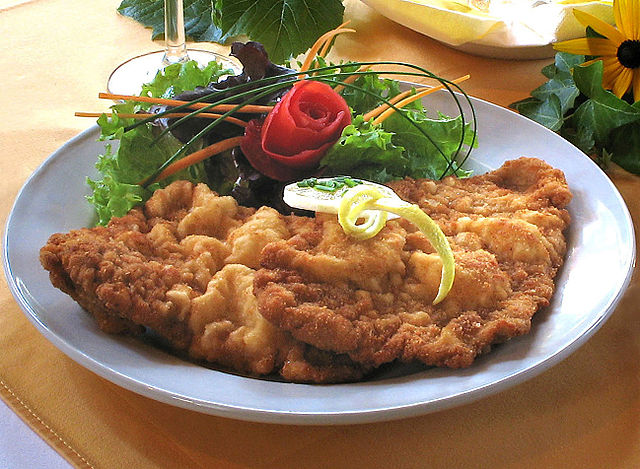 Surely a trip to Germany is incomplete without a delicious slab of steaming Schnitzel? (Photographer: Kobako; Wikipedia)