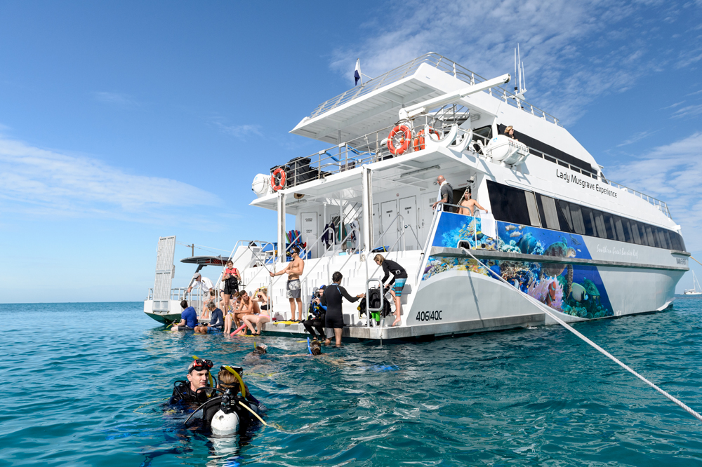 Luxury cruiser Main Event is the hopping off point for snorkelers and the glass bottom boat to explore the reef. Photo: writer's own