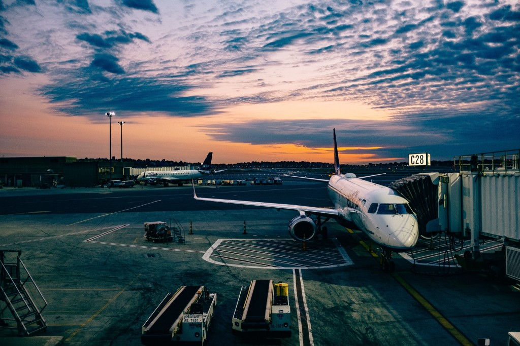 Grounded by responsibilities, the departure gate is shut. Photo © Ashim D'Silva via Unsplash